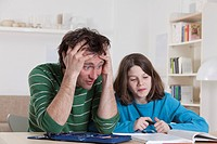 Germany, Bavaria, Munich, Father helping son with homework