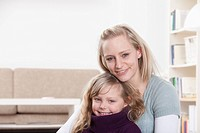 Germany, Bavaria, Munich, Mother and daughter sitting at home