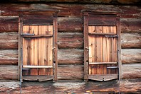 The old rustic Log Wall and closed Windows