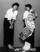 NEWSBOYS, c1920.Actresses portraying newsboys in a production of the play 'Gassenbuben,' Vienna, c1920.