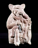 MAYAN FIGURE, 700-900 A.D.Mayan painted ceramic figure of a jaguar eating a man. From Jaina, Campeche, Mexico. Height: 12.5 cm.