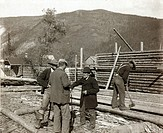DAWSON CITY, c1897.Men trimming logs to construct log cabins in the gold mining town of Dawson City, Yukon Territory, Canada. Photograph, c1897.