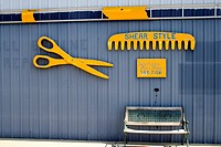 Scissors and comb signage for a hair salon barbershop  Clitherall Minnesota MN USA