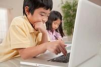 Korean boy using laptop