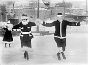 ICE SKATERS.Marie O'Connell and Lincoln Elkman ice skating together, wearing Santa Claus suits. Photograph, late 19th or early 20th century.