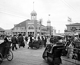ATLANTIC CITY, c1900.The boardwalk and the Steel Pier amusement park in Atlantic City, with wheeled chairs in the foreground.