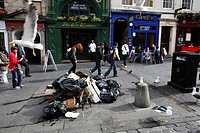 Scotland, City of Edinburgh, Edinburgh. Seagulls looking for food amongst rubbish bags piled on the Royal Mile during a period of industrial action by...