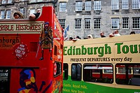 Scotland, City of Edinburgh, Edinburgh. Tourists onboard double decker sightseeing buses in the Old Town of Edinburgh