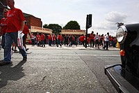 England, Merseyside, Liverpool. Liverpool football fans and burger vans on Anfield Road on a match day before kick off