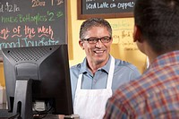 Cafe owner serving customer