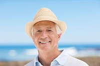Close up of smiling senior man in hat