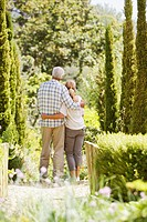 Senior couple hugging in garden
