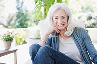 Senior woman sitting on patio