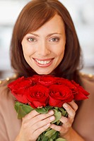 Close up of woman holding roses