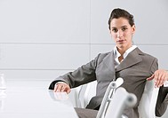 Businesswoman sitting in conference room