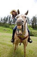 A teenaged girl riding a horse in Reardan, Washington, USA