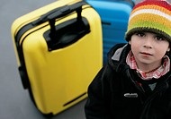 Boy looking at camera, Munich airport, Bavaria, Germany