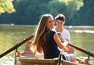 Couple in rowing boat on a lake