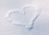 Heart drawn on the fresh snow