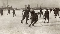 ICE HOCKEY, 1912.A group of young textile mill boys playing ice hockey on a Sunday morning on Park Pond in New Bedord, Massachusetts. Photograph by Le...