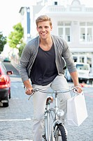 Portrait of a young man cycling