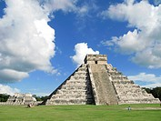 Tourists walking in front of a pyramid, Kukulkan Pyramid, Chichen Itza, Yucatan, Mexico