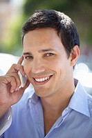 Mid adult man talking on a mobile phone