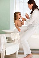 Woman giving a bath to her daughter (thumbnail)