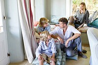 Family sitting together at house (thumbnail)