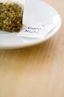 Close_up of a herbal teabag in a plate