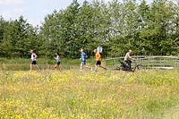 People jogging and biking in Nature Reserve Bloeidaal. This is a parcel of former farm landscape given back to nature. Foundation Het Utrechts Landsch...