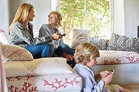 Children and mother using electronic gadgets at home