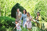 Happy multi generation family enjoying in the garden