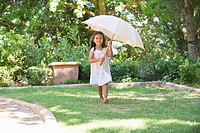Cute little girl holding an umbrella