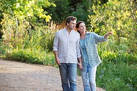 Happy mature couple walking in a garden