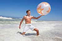 Man playing with beach ball