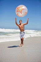 Man playing with beach ball (thumbnail)