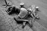 Poor Beggar sleeping on the Street