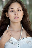 Portrait of a beautiful young woman wearing shell's necklace