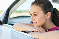 Young woman looking out of car window (thumbnail)
