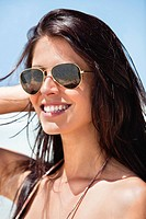 Close_up of a young woman wearing sunglasses