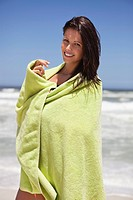 Portrait of a woman wrapped in a towel on the beach