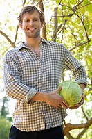 Portrait of a man holding a cabbage (thumbnail)