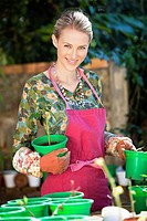 Portrait of a woman gardening and smiling