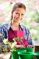 Portrait of a girl gardening and smiling
