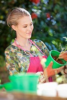 Young woman gardening and smiling