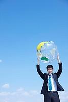 businessman raises the globe