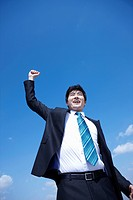 businessman raising his arms