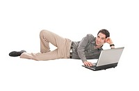 Businessman lying down with laptop