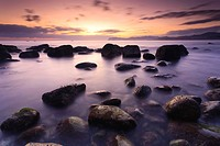 Cove with ´arribolas´ boulders at sunrise, Urdaibai, Vizcaya, Basque Country, Spain